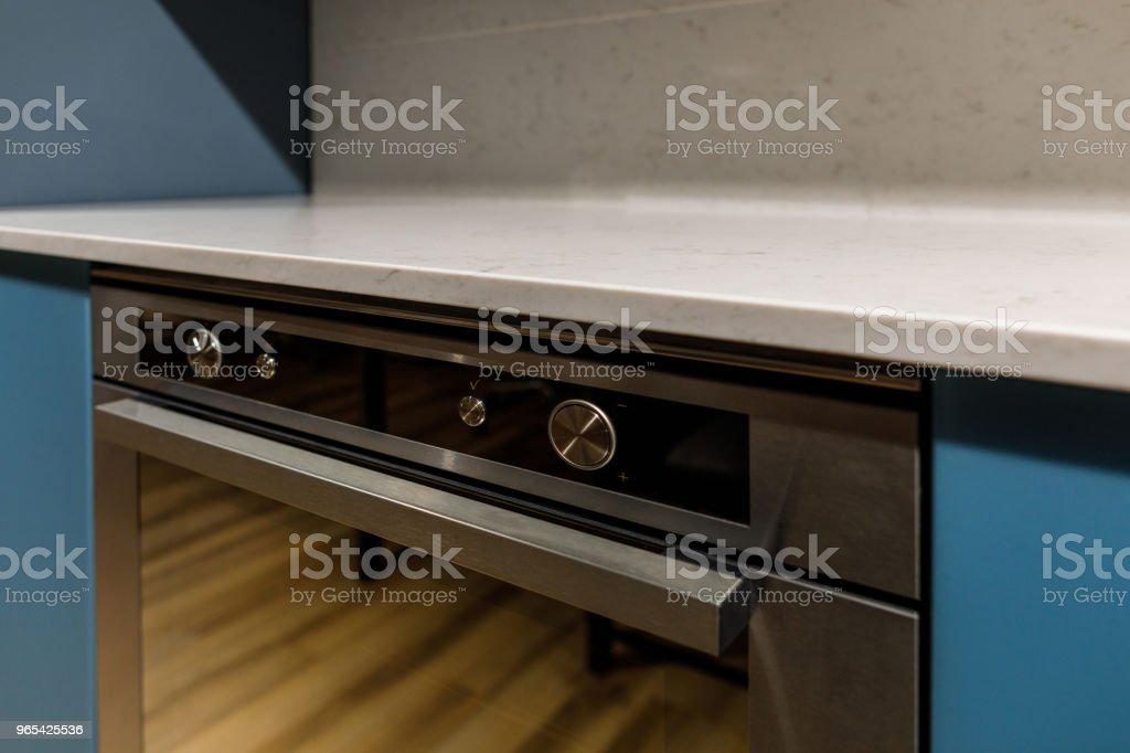 Close-up view of metal oven in modern kitchen royalty-free stock photo