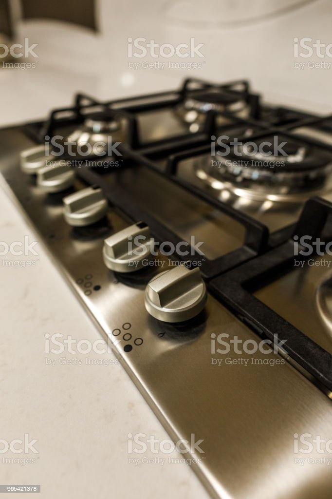 Close-up view of metal stove in stylish kitchen royalty-free stock photo
