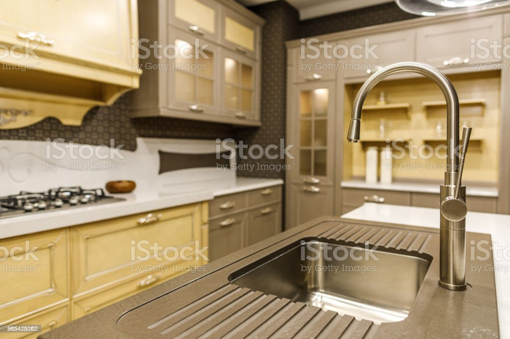 Close-up view of modern sink in renovated kitchen royalty-free stock photo