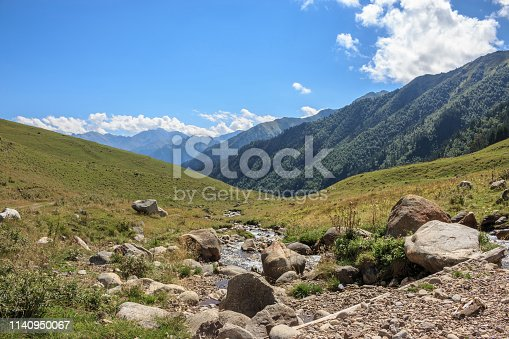 Closeup view of mountains scenes in national park Dombay, Caucasus, Russia, Europe. Dramatic blue sky and sunny summer landscape