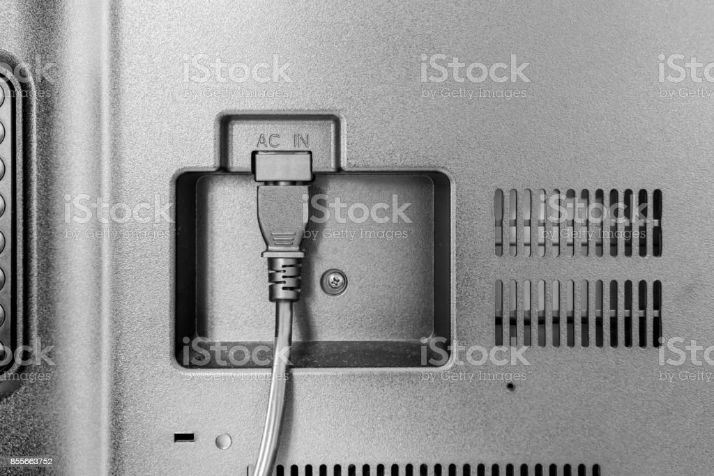 closeup view of power cable plug into the television AC IN input stock photo