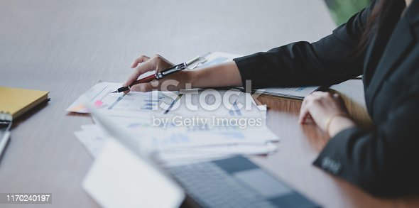 1068752548istockphoto Close-up view of professional businessman planing his strategy 1170240197