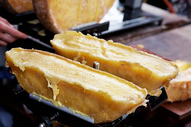 raclette chese - raclette photos et images de collection