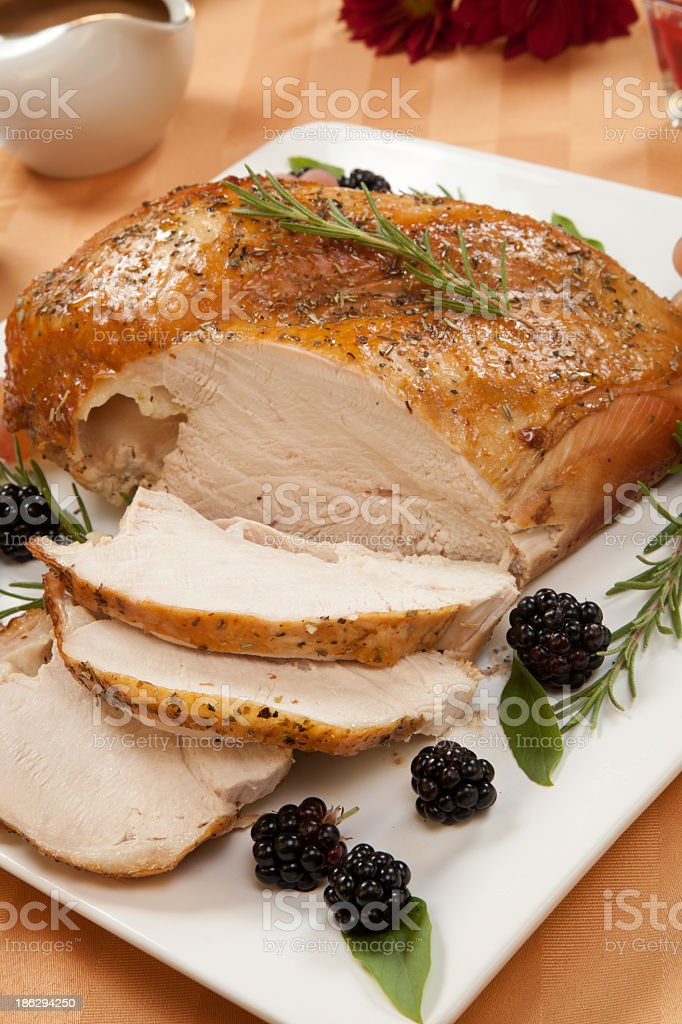 Close-up view of roasted turkey with rosemary-basil rub stock photo