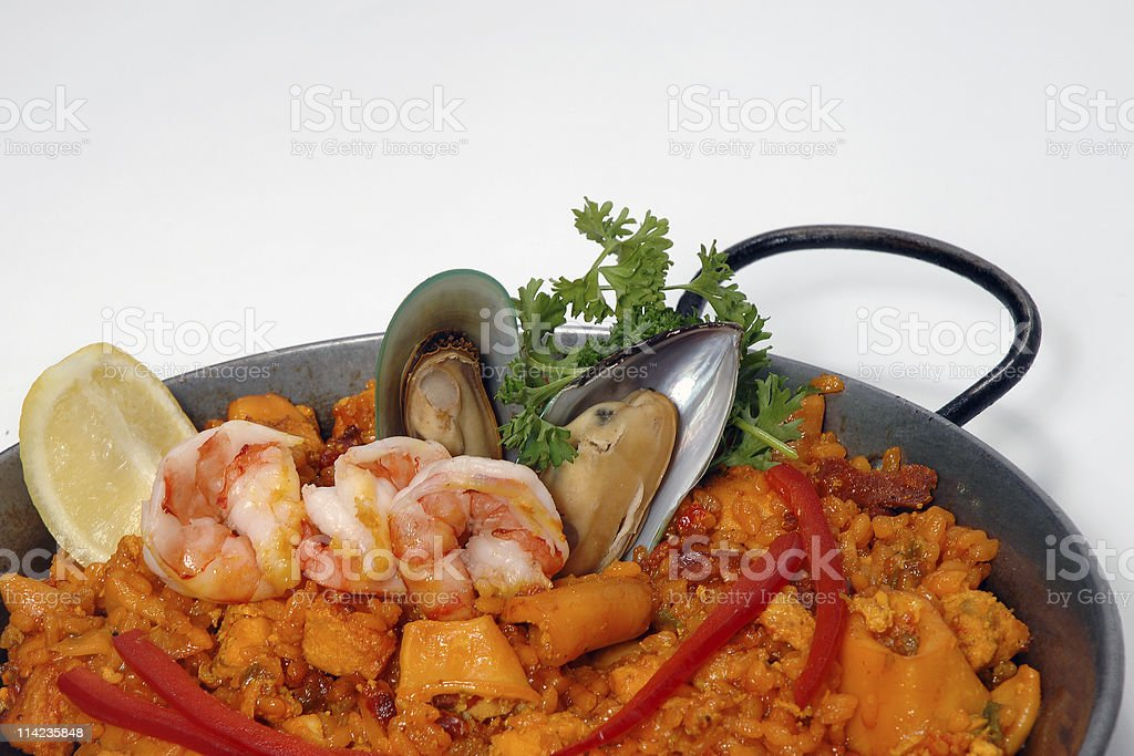 Close-up view of Seafood Paella against a white background royalty-free stock photo