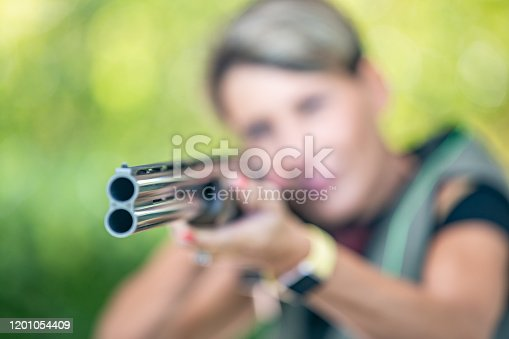 Close-up View of Shot Gun Muzzle Held by Unrecognizable Adult Woman