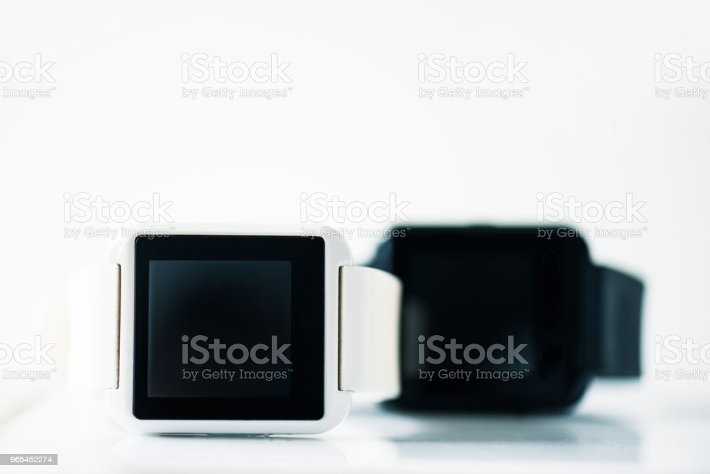 close-up view of smartwatches with black screens on grey royalty-free stock photo