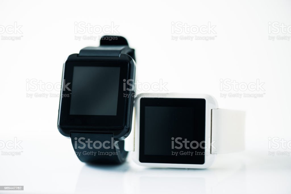 close-up view of smartwatches with blank screens isolated on grey royalty-free stock photo