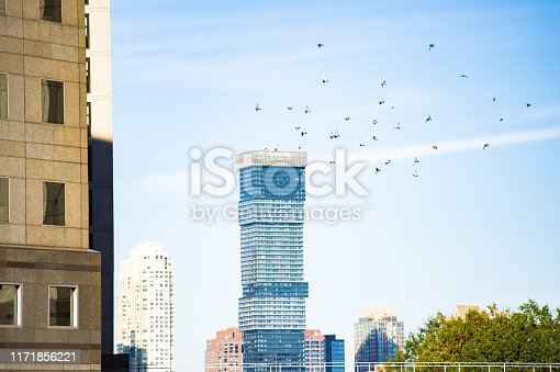 Close-up view of some buildings and skyscrapers during a stunning sunset. Downtown Manhattan, New York City, United States of America.