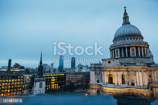 istock Closeup view of St. Pauls Cathedral and evening London cityscape 1214813315