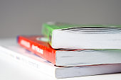 istock Close-up view of   stack  of  books  on the  table  . Reading at home in your free time . 1223770106