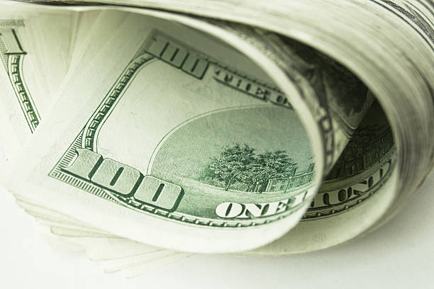 Close-up view of stack of US dollars stock photo