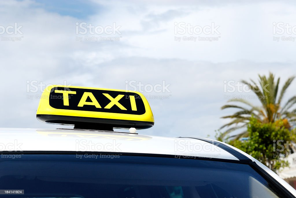 Close-up view of taxi placard on top of a cab royalty-free stock photo
