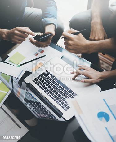 istock Closeup view of teamwork proccess.People hands, holding report paper documents, typing laptop.Vertical. 931830254