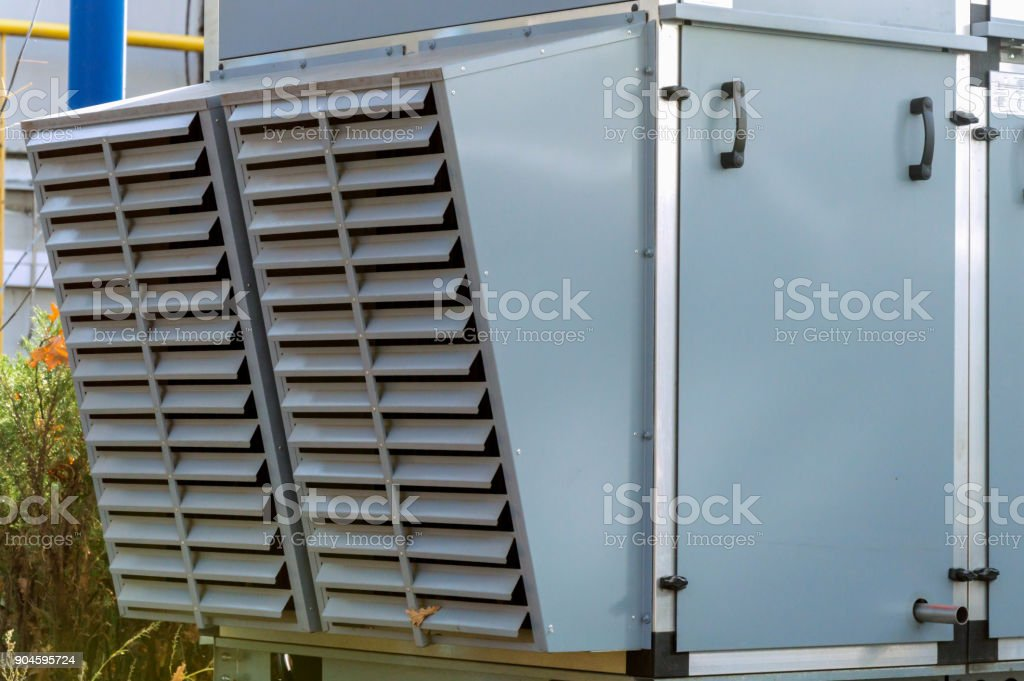 Close-up view of the big commercial air handling units louvres stock photo