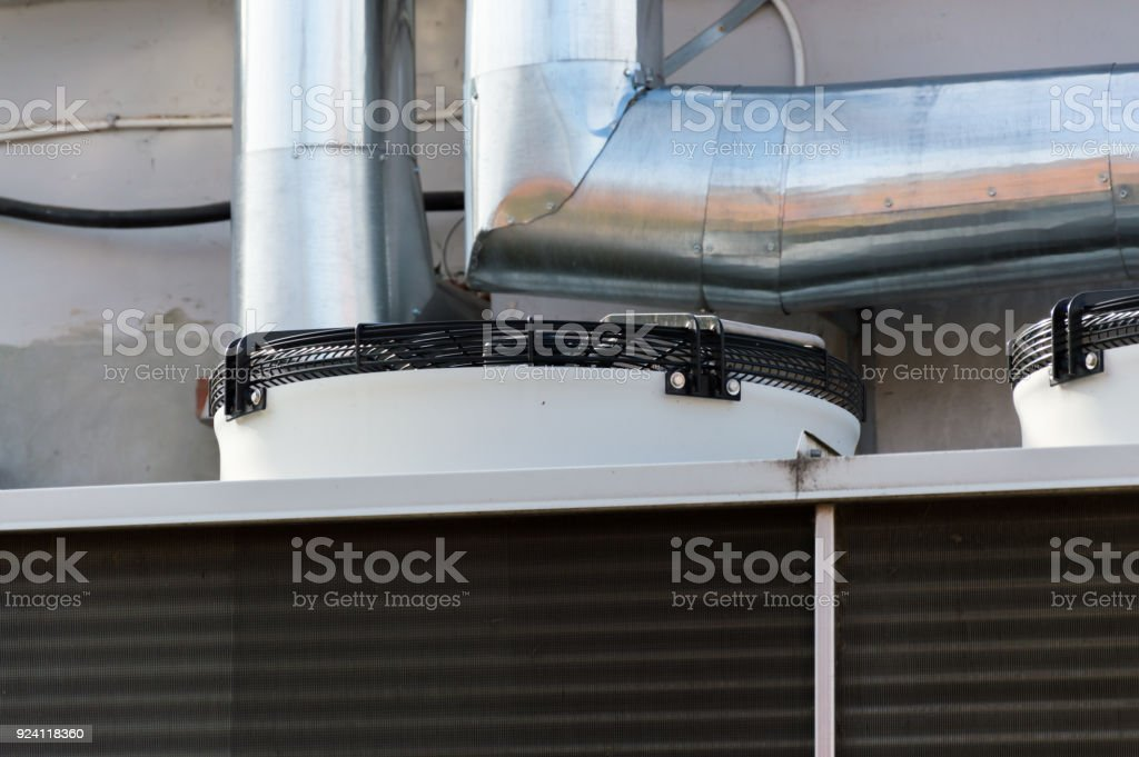 Close-up view of the fans of gray industrial cooling unit for central ventilation system stock photo