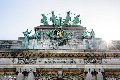 Close-up view of the quadriga atop the arcade du Cinquantenaire, the triumphal arch erected in 1905 by king Leopold II in the Cinquantenaire park in Brussels, Belgium, against the sunlight.
