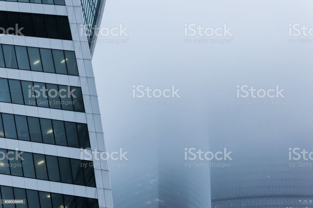 Close-up view of the side wall of the modern building standing into scotch mist stock photo