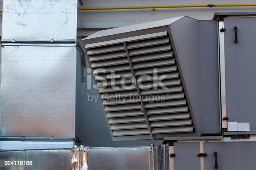 istock Close-up view of the ventilation louvres of the gray industrial ventilation unit standing outdoor 924118168