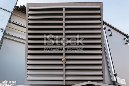istock Close-up view of the ventilation louvres of the gray industrial ventilation unit standing outdoor 924118298