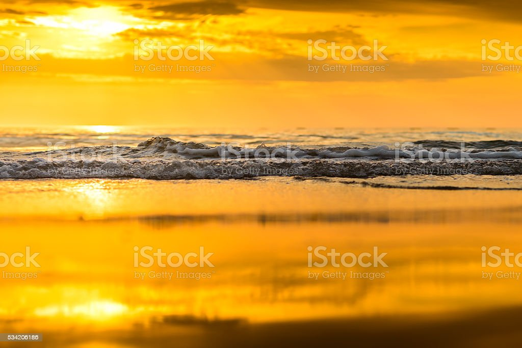 Close-up view of the waves at sunset stock photo