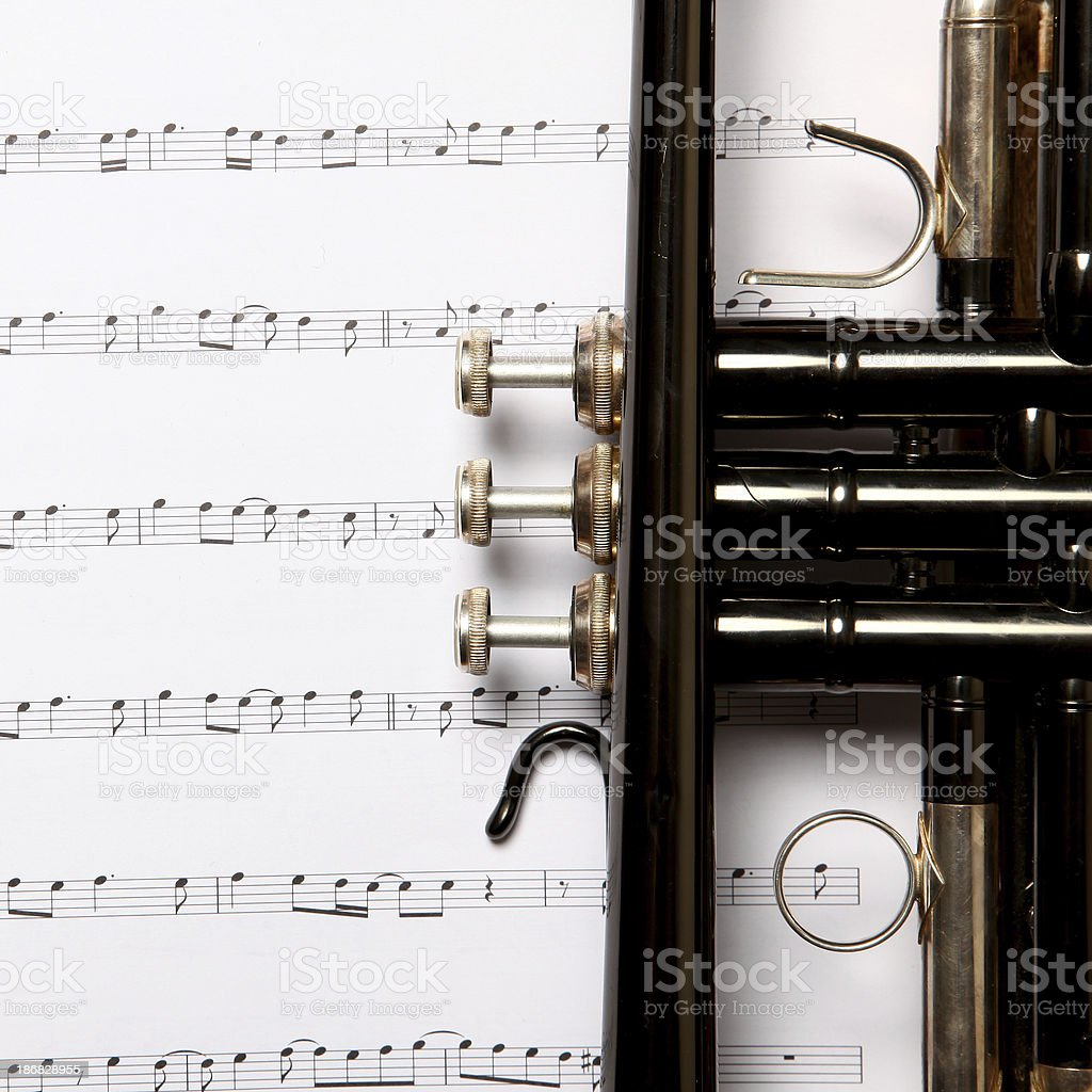 Close-up view of Trumpet on a music notes royalty-free stock photo