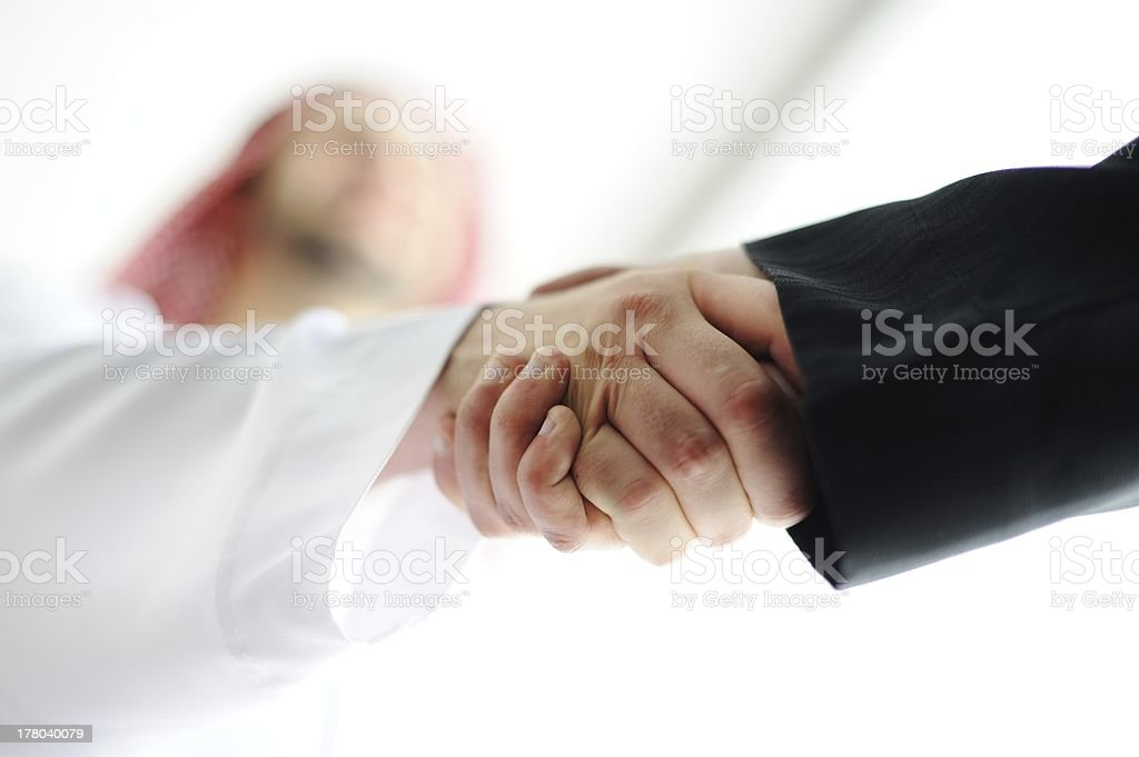 Close-up view of two people shaking hands stock photo