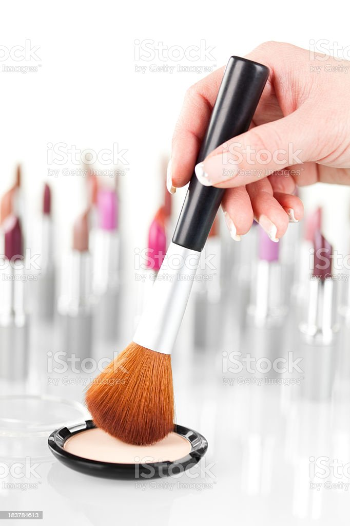 Close-up view of woman's hand holding make-up brush royalty-free stock photo