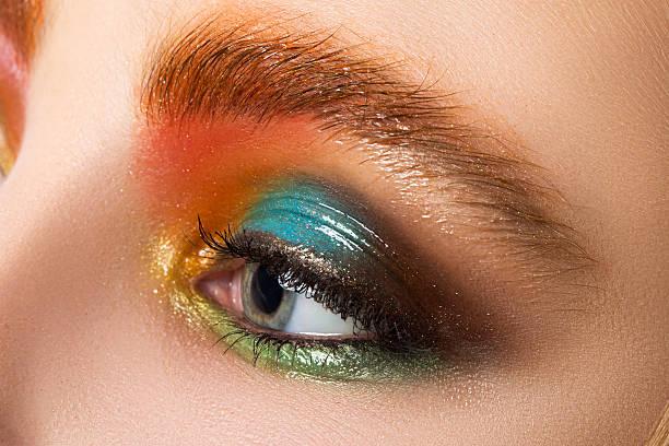 close-up view of women eye with beautiful modern make-up - blaues augen make up stock-fotos und bilder