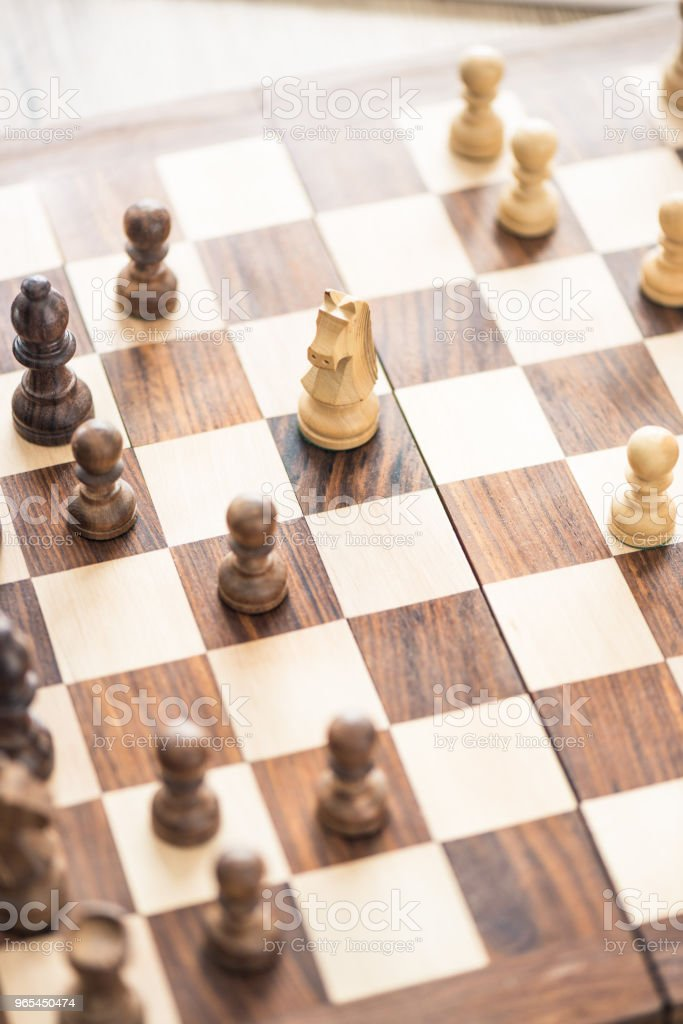 close-up view of wooden chess board with chess board royalty-free stock photo