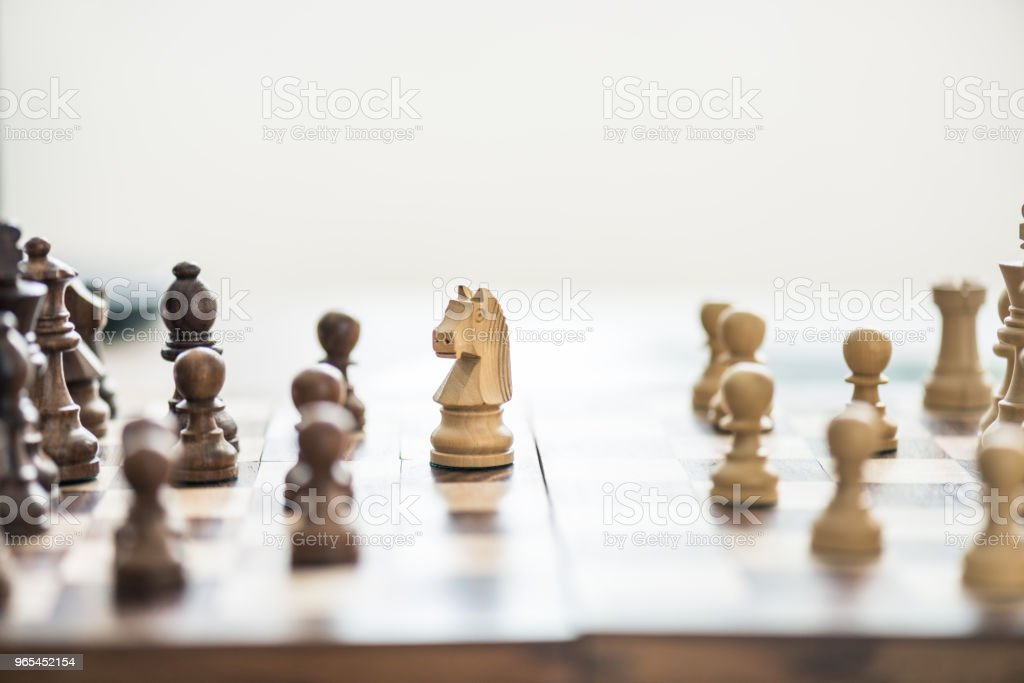 close-up view of wooden chess figures on chess board, selective focus royalty-free stock photo