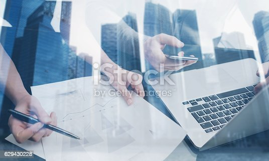 629421870 istock photo Closeup view of young team working together with modern gadgets 629430228