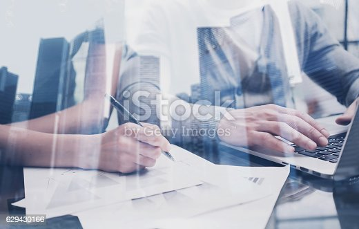 629421870 istock photo Closeup view of young team working together with modern laptop 629430166