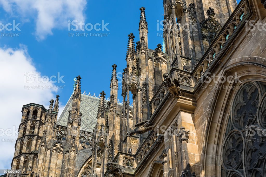 Closeup view on gothic cathedral of St. Vitus with blue sky in Prague Castle, Prague, Czech Republic stock photo