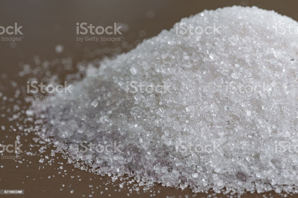 Closeup view on granulated white sugar stock photo