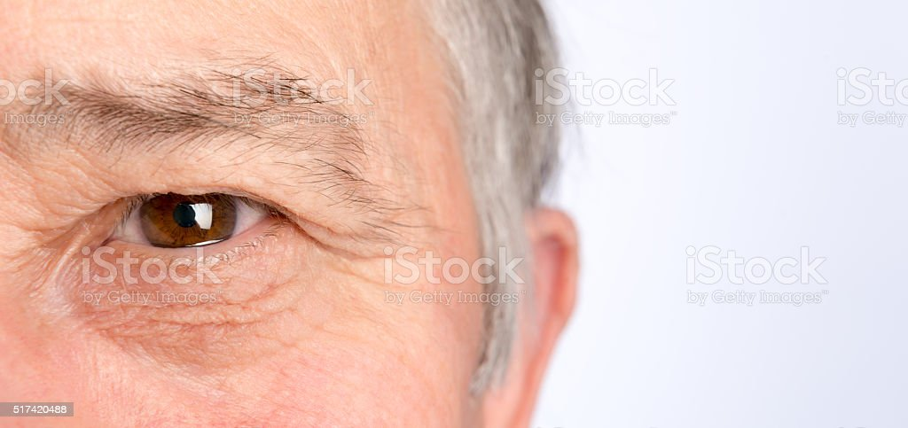Close-up view on the eye of senior man. Horizontal photo stock photo