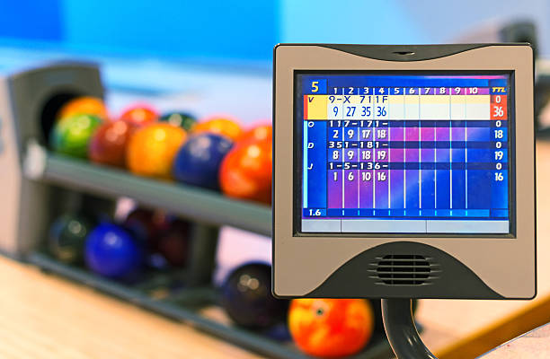 close-up view score monitor in bowling club. - scoring stock photos and pictures