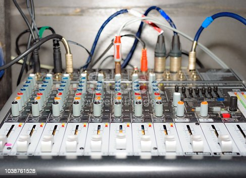 istock Close-up view the mixer panel of the sound producer with handles 1038761528