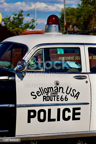 """Seligman, Arizona, USA - July 30, 2020: Close-up of a vintage police car with a """"Cherry Top"""" emergency light in downtown Seligman, Arizona."""