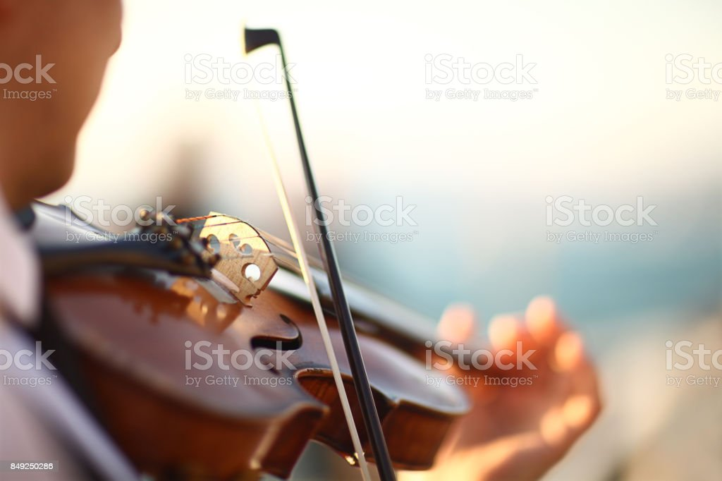 Close-up violin playing stock photo
