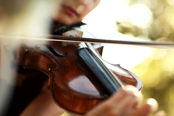 close-up violin playing - classical style stock photos and pictures