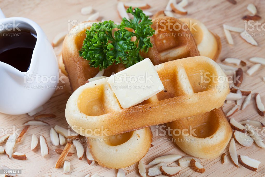 Close-up waffles and nut with parsley and cheese on top stock photo