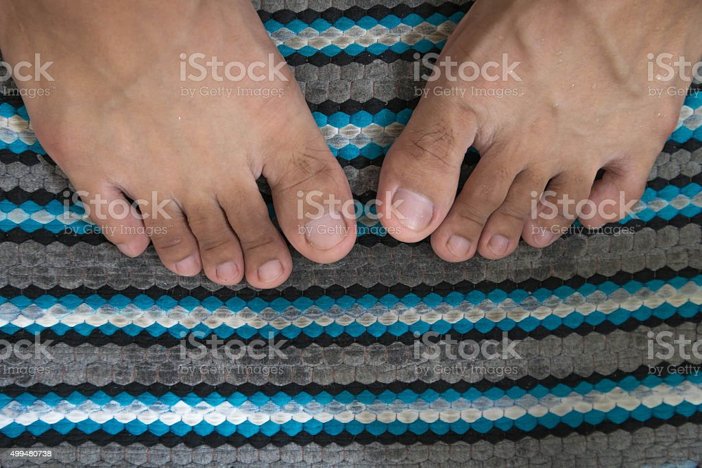 Close-up wet feet on wet foot scraper stock photo