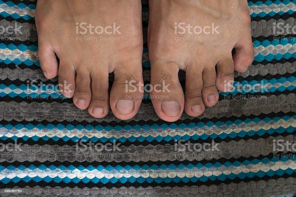 Close-up wet feet on wet foot scraper Close-up wet feet on wet foot scraper 2015 Stock Photo