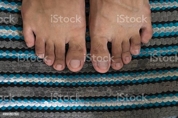 Closeup Wet Feet On Wet Foot Scraper Stock Photo - Download Image Now