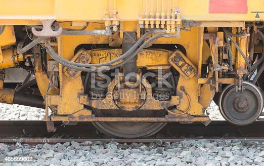 istock closeup wheel break and suspension system of diesel train 465859602