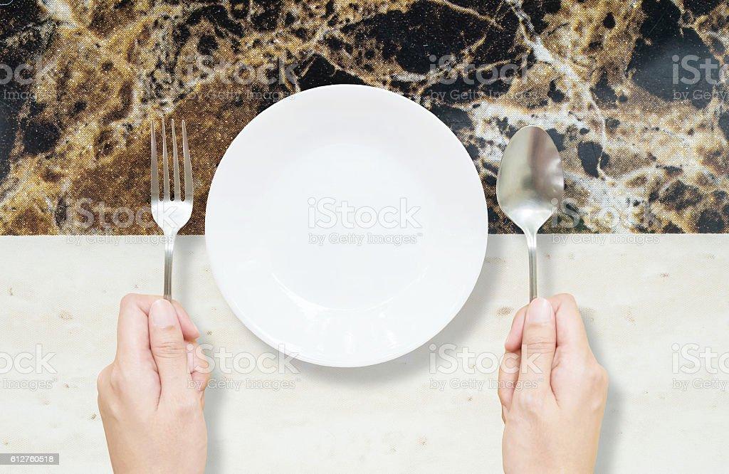 Closeup white ceramic dish on black and white marble stone stock photo