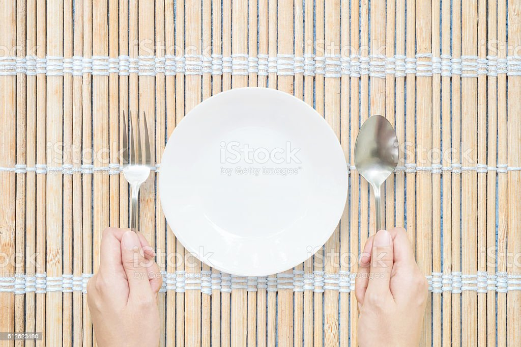 Closeup white ceramic dish with stainless fork and spoon stock photo