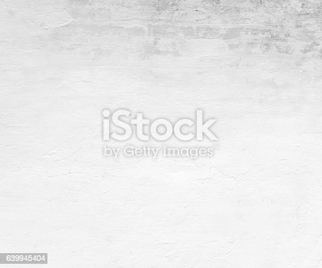 istock Close-up white grunge old wall texture concrete cement background 639945404
