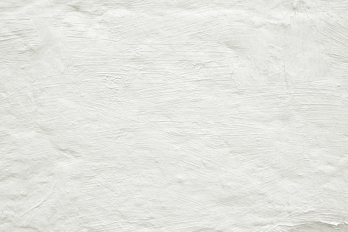 Close-up white painted grunge old wall texture background